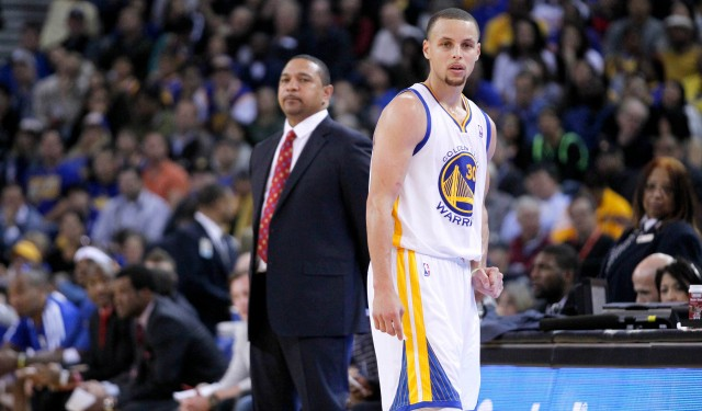 Mar 30, 2014; Oakland, CA, USA; Golden State Warriors guard Stephen Curry (30) looks on in front of head coach Mark Jackson during action against the New York Knicks in the fourth quarter at Oracle Arena. The Knicks won 89-84. Mandatory Credit: Cary Edmondson-USA TODAY Sports