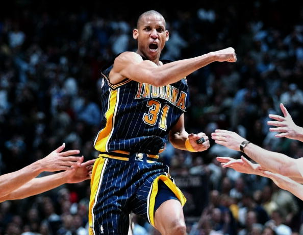 EAST RUTHERFORD, UNITED STATES:  Indiana Pacers' guard Reggie Miller celebrates after hitting a three-pointer as time expired to send the game into overtime 02 May 2002 at Continental Airlines Arena in East Rutherford, NY. Miller later sent the game into double-overtime with another last-second shot, but the Nets beat the Pacers 120-109 in double overtime to win the best-of-five first round Eastern Conference series 3-2 and advance to the next round against the Charlotte Hornets. AFP PHOTO/Matt CAMBPELL (Photo credit should read MATT CAMPBELL/AFP/Getty Images)